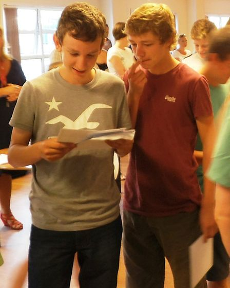 Students at The King's School inspect their GCSE results