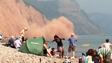 A huge cliff fally took place in Sidmouth on Wednesday as the nearby beach was packed. Photo by Hele