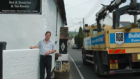 Andrew Flaherty, manager of Southern Cross tea rooms, Newton Poppleford, outside his business on the