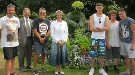Andy Williams and family are pictured with Gilbert and Sidmouth in Bloom's Lynette Talbot and Peter