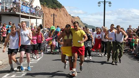 Competitors head off from Port Royal in the Sidmouth Regatta three legged race on Saturday. Photo by