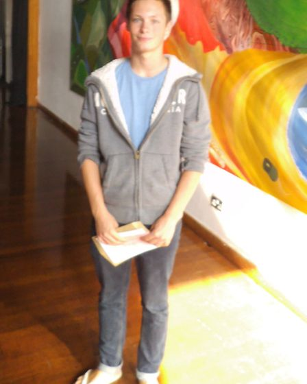 Sidmouth College student Jasper Dommett with his GCSE results