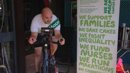 Phil Dix, sundries buyer at Otter Nurseries takes to the static bike to complete his leg of the chal