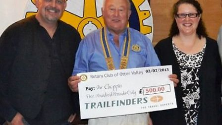 Rotary president Jim Cobley and colleagues handed the first prize, generously donated by Trailfinder