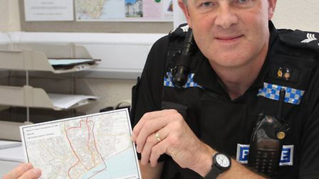 Sergeant Andy Squires with the dispersal zone map. Photo by Simon Horn. Ref shs 6365-33-13SH To orde