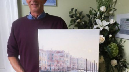 Rob Crisp with one of his paintings of Venice