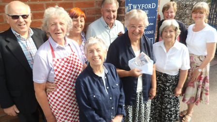 Members from Sidmouth Voluntary Services celebrate receiving £1,198 from a mystery benefactor. A del