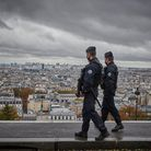 Armed French Police patrol in Paris on All Saints Day