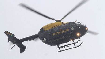 A police helicopter was seen hovering around Sidmouth on Thursday, 26 September. Picture by Alex Wal