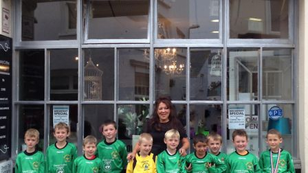 Sidmouth Warriors Under-8s with sponsor Gill Harris of Coastal Coffee Lounge