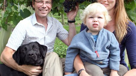 Andrew Simmons and Rebecca Russell with son Daniel Simmons and their dog Buster. The family are look