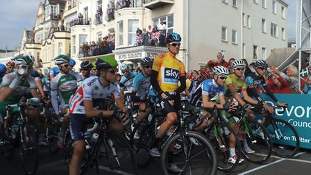 Yellow jersey holder, Sir Bradley Wiggins, peprares to lead the line on the Esplanade. Photo by Harv
