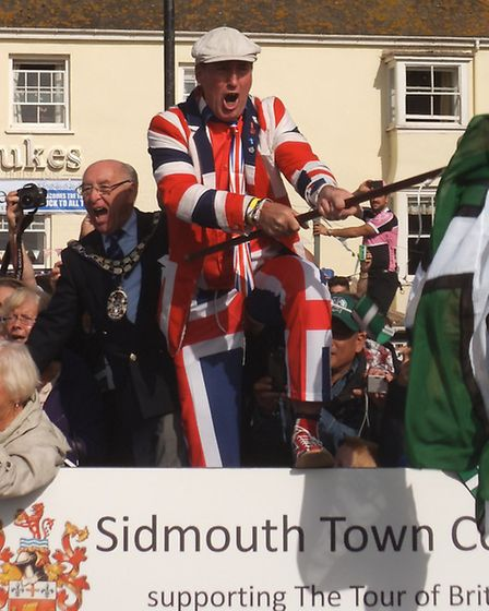 A colourfully clad Stuart Hughes starts the race on Sidmouth seafront. Photo by Harvey Gavin.
