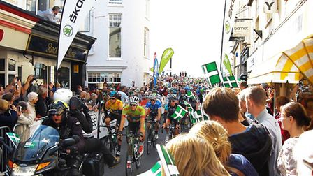 Riders race down Fore Street in Sidmouth, Photo by James Woollacott.