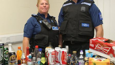 Sidmouth town PCSO's Jay Bowden and Phil Thomas with the haul of alcoholic drinks seized from under