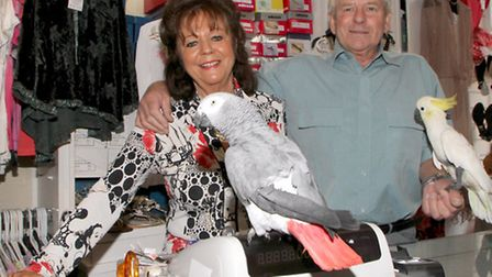 Gordon and Ann Down close up their shop, Feathers, and take a well earned retirement. Gordon holds h
