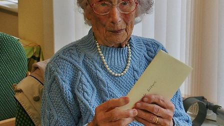 Hilda Billson, 102, opens a birthday card presented to her by Sidmouth Voluntary Services at Twyford