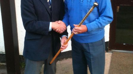 Walking Stick winner Bob Cook recieves the trophy