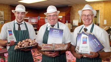 Staff at Hayman's Butchers of Sidmouth celebrate their success at winning a number of awards at a re