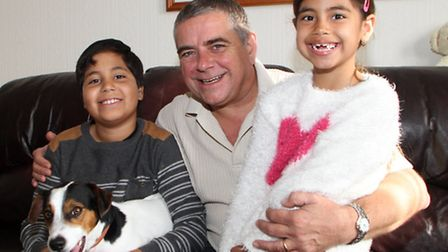 Steve Carter from Beer and his children Harry, ten and Sammi, six with Billy the dog. Steve is tryin