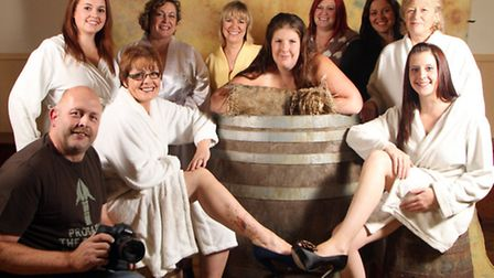 The lady tar barrelers pose for their Calendar Girls photo shoot. The man behind the lens, photograp