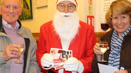 Our picture shows Father Christmas with two members of the audience of A Bone to Pick with Santa at