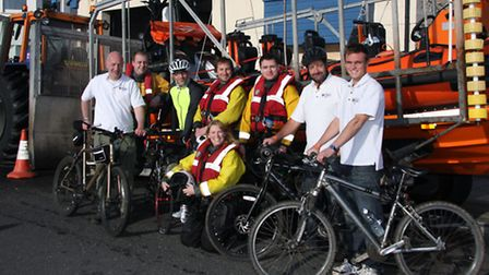 Sidmouth lifeboat crew with cyclists Glyn Jones,John Kennedy,Phil Marish and Michael Benzon, not in