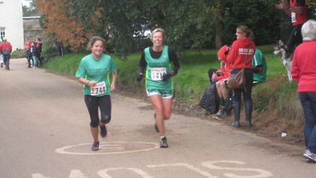 Sidmouth RCs Abbi Lee and Becky Robson coming to the finish line in the 2013 Bicton Blister..