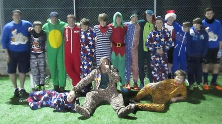Sidmouth Raiders Under-14s line up in their onesie's at a midweek training session.