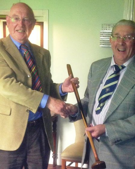 Sidmouth Snooker captain John Carroll presents 'The Trophy' to the Golf Club's John Lewis.