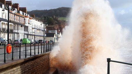 Giant waves smash against the sea wall at Sidmouth. Picture by Alex Walton. Ref shs 2282-01-14AW. To
