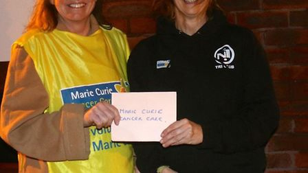 Sally Hutter presents a cheque to Angel Booth the Marie Curie fund-raising chairman in the Honiton a