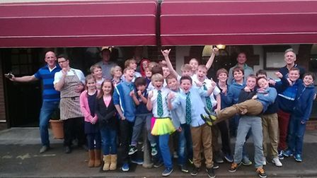 The Sidmouth RFC and Sidmouth AFC Under-12 squads outside Newton Poppleford restaurant La Rosetta wh