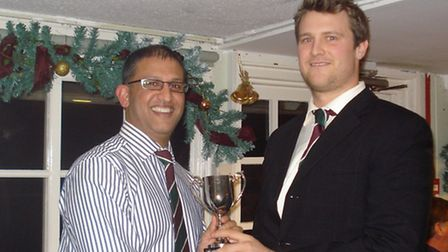 Liam Lewis recieves one of his three awards at Sidmouth CC