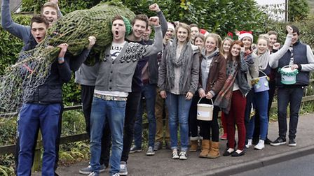 Students of Sidmouth college on their annual christmas tree carry around the town. Photo by Terry If