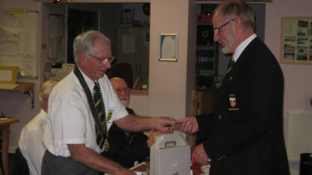 Sidmouth bowler Brian Smith receives his County Badge