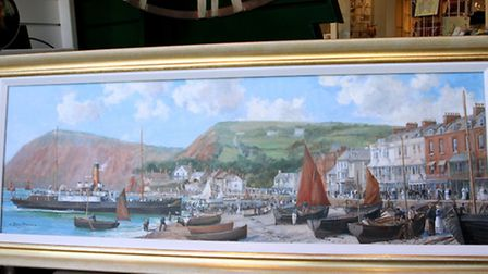 This delightful painting of Sidmouth beach and seafront which iws on display in the window of Pure I