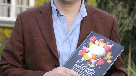 Salty Monk owner Andy Witheridge with a copy of the book
