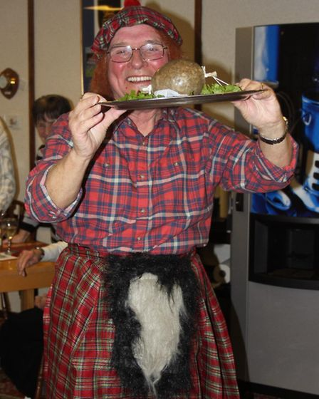 Haggis being piped in and taken around by quizmaster John Greenaway, resplendent in kilt and tam-o'-