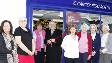 Manager Diane Davies with local artist George Hutchinson when he re-opened the Cancer research shop