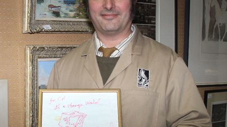 David Sumner of Otter Auction Rooms with a Damien Hirst sketch which is due to go under the hammer.