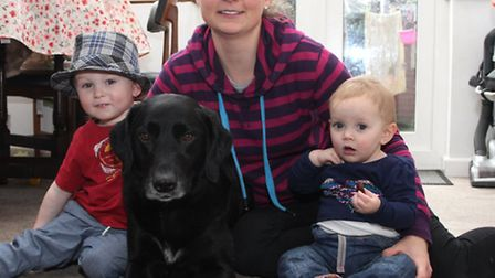 Jessica Rainor with two and a half year old Zach, Indi who is nearly one and their dog Dude. Photo b