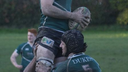 Sidmouth 2nds keep warm by practising after a Newton Abbot player suffers an ankle break. Photo by T