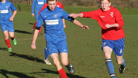 Brixington Blues U15's (in red tops) are pictured playing their Ottery counterparts at Withycombe Co