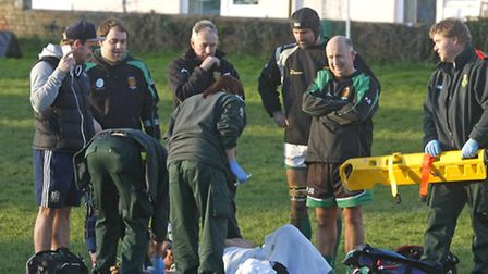 A Newton Abbot player is injured during the game against Sidmouth 2nds. Photo by Terry Ife. Ref shsp