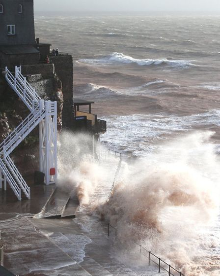 Spectacular waves pound the area around Jacob's Ladder at Sidmouth on Monday. Photo by Simon Horn. R