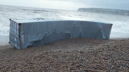 The shipping container washed up on Seaton beach with millions of cigarettes inside. Photo by Roger
