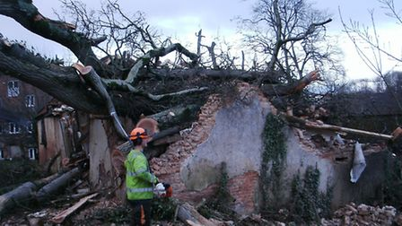 A large oak tree smashed into a barn at Fairmile, which temporarily blocked the road alongside Mill
