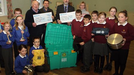 Children from Tipton St John and Feniton primary schools presented cheques to Shelter Box and the Me