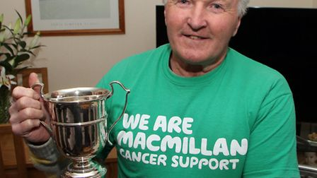 Mervyn Gratton with the Macmillan Cancer Relief Cup which he was awraded for his charity fundraising
